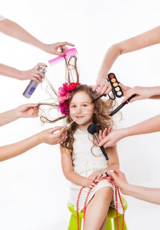 little girl in a beauty salon