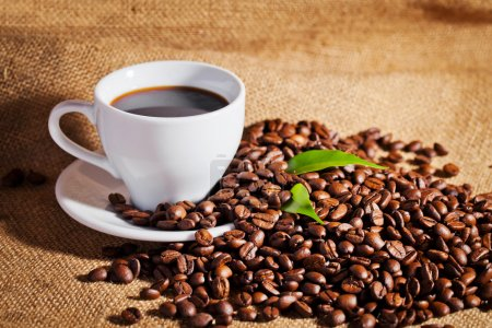 Coffee cup and arabica beans on cloth sack