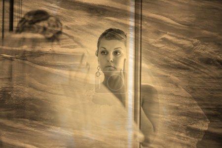 retro sepia black and white photo, bride looks in the mirror in
