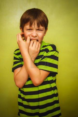 Baby boy teenager feels fear anxiety bad habit biting