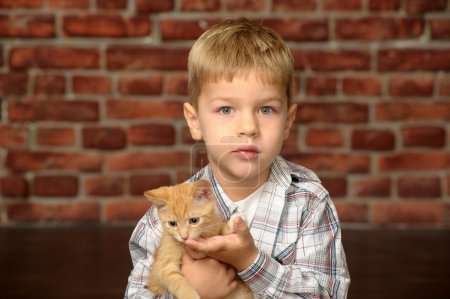 Boy with a small kitten