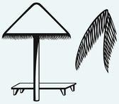 Palm leaf and beach umbrella