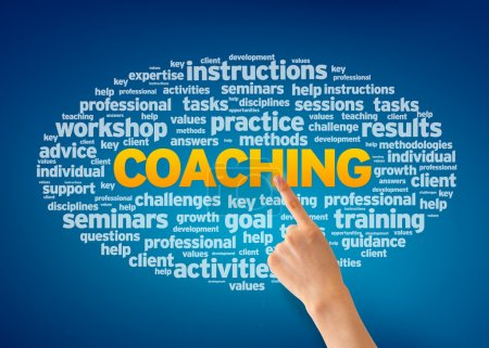 Photo for Hand pointing at a Coaching Word Cloud on blue background. - Royalty Free Image