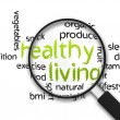 Magnified Healthy Living word illustration on whit...