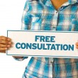 A woman holding a Free Consultation sign....
