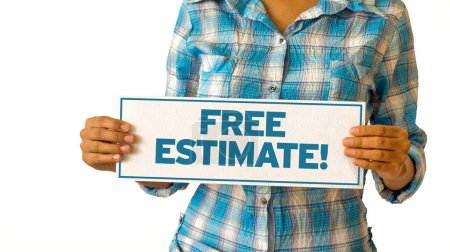 Photo for A woman holding a Free Estimate sign. - Royalty Free Image