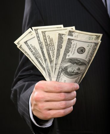 Businessman holding money in his hand