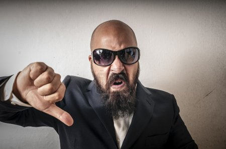 Man bouncer with sunglasses and negative expression