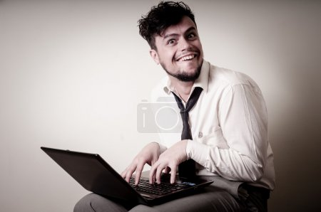 Photo for Funny businessman using notebook on gray background - Royalty Free Image