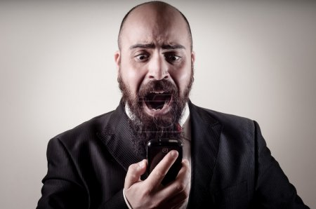 funny elegant bearded man screaming on the phone