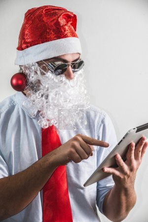 funny santa claus babbo natale using tablet