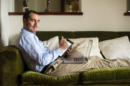 Photo for Elegant business multitasking multimedia man using devices at home - Royalty Free Image