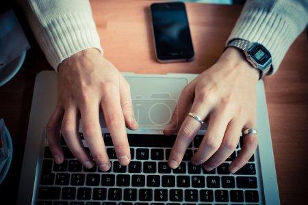 Close up hands multitasking man using tablet