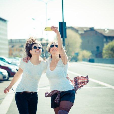 Two women using smart phone