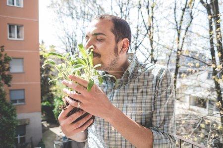 handsome stylish man gardening
