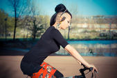 Punk girl riding bike