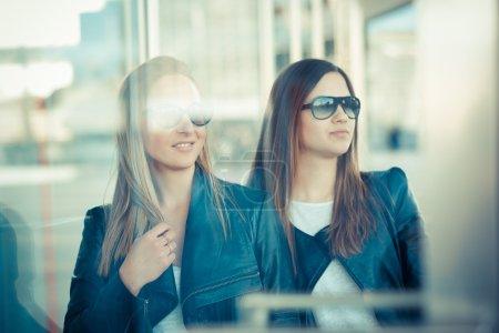Two  women through glass