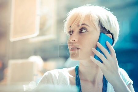 Hipster woman using smart phone