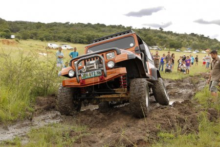 Crush Beige Jeep Wrangler Off-Roader V8 crossing mud obstacle