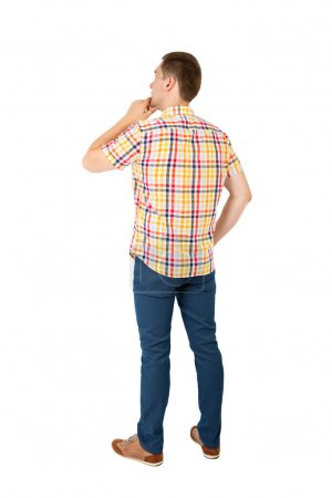 Back view of handsome man in yellow shirt