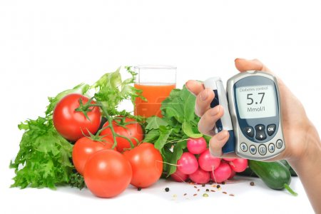 Photo for Diabetes concept glucose meter in hand and healthy organic food - Royalty Free Image