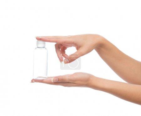 Hand hold empty glass or plastic shower gel cream ...