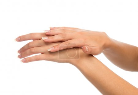 Beautiful woman hands with french manicure nails