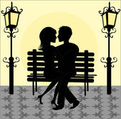 silhouette of a loving couple on a bench