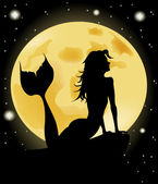 Mermaid silhouette against the background of the full moon
