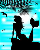 Beautiful mermaid silhouette on a background of blue sky summer