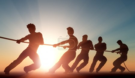 Photo for Group of pulling the rope in the sunlight. - Royalty Free Image