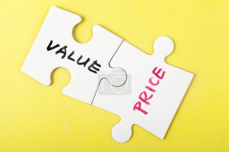 Photo for Value and price words written on two pieces of jigsaw puzzle - Royalty Free Image