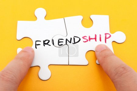 Photo for Friendship word written on two pieces of puzzle - Royalty Free Image