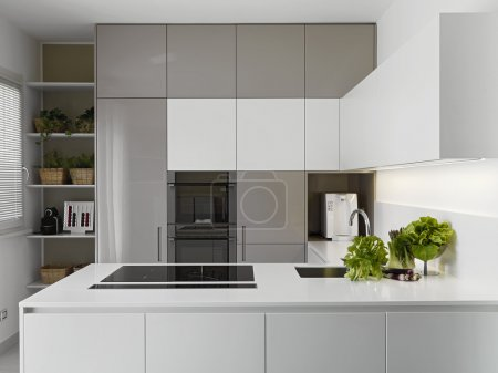 Photo for Modern kitchen with vgetables on the white worktop - Royalty Free Image