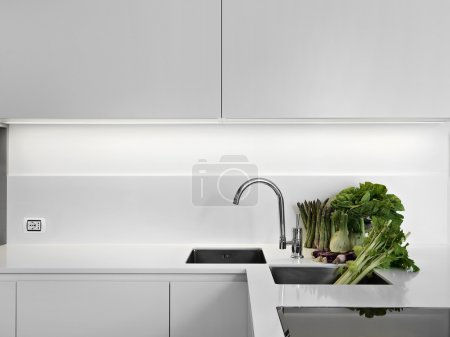 Vegetable on white laminate worktop in the kitchen