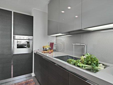 Vegetables near to sink in a modern kitchen