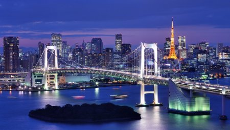 Photo for Rainbow Bridge spanning Tokyo Bay with Tokyo Tower visible in the background. - Royalty Free Image