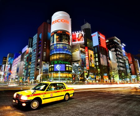 Photo for TOKYO - DECEMBER 25, 2012: A Taxi at Ginza District December 25, 2012 in Tokyo, JP. Ginza etends for 2.4 km and is one of the world's best known shopping districts. - Royalty Free Image