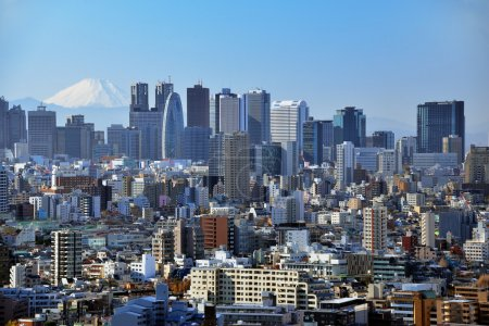 Photo for Skyscrapers in the Shinjuku Ward of Tokyo with Mt. Fuji visible. - Royalty Free Image