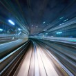 Motion blur of a city and tunnel from inside a mov...