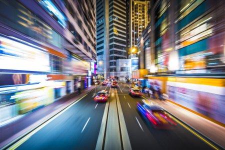Photo pour Hong Kong, Chine mouvement flou à travers la ville depuis un tramway . - image libre de droit