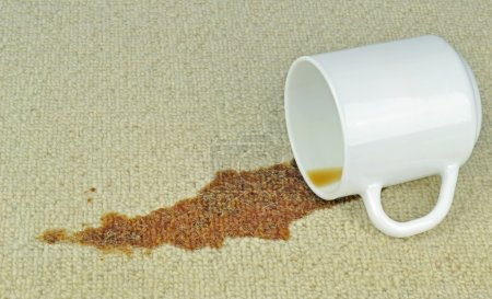 Photo for A spilled cup of coffee on a carpet with stain - Royalty Free Image