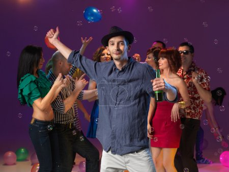 Photo for Young man with hat and beer dancing on bakcground with , ballons and bubbles - Royalty Free Image