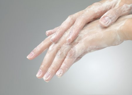 hands with soap foam ad bubbles