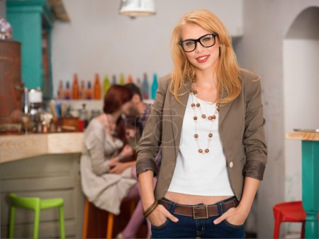 young caucasian blonde girl in cafe