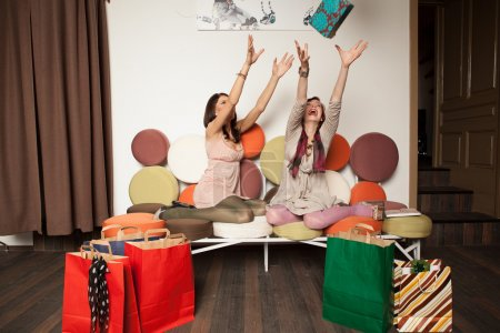 girls trying to catch a gift box