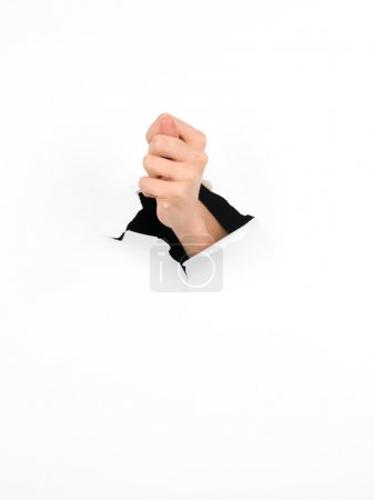 thumb gesture through white paper