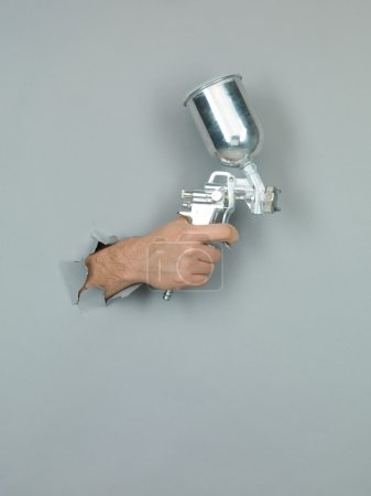 male hand holding a spray gu