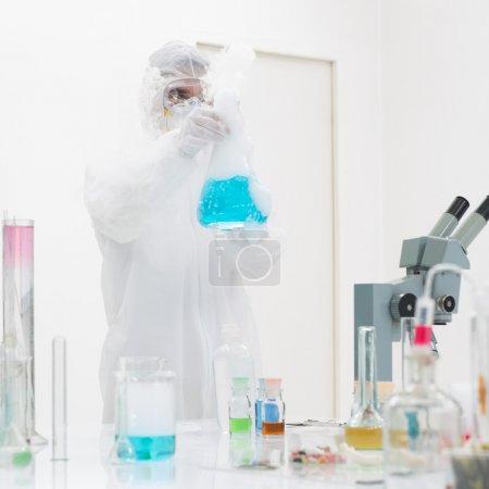 researcher manipulating laboratory tools