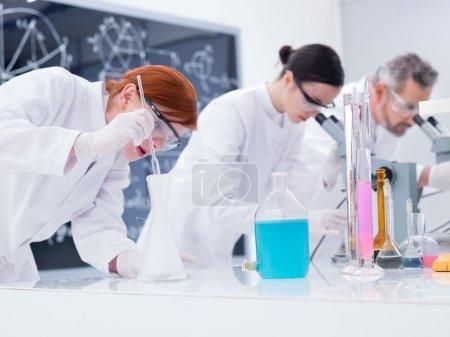 Scientists conducting lab experiments